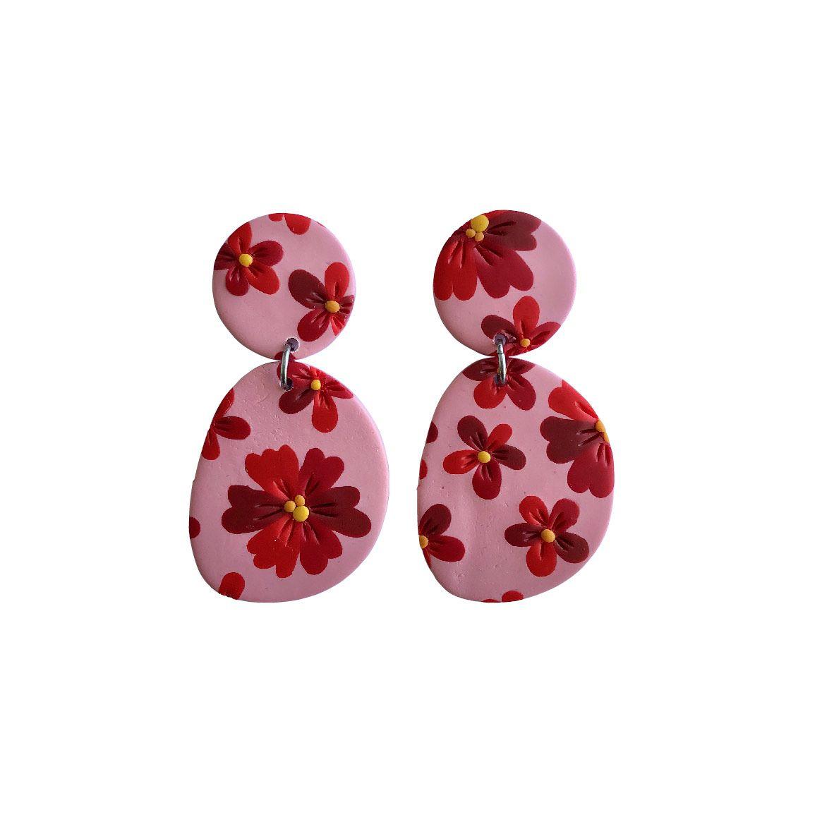 Aros rosados flores rojas