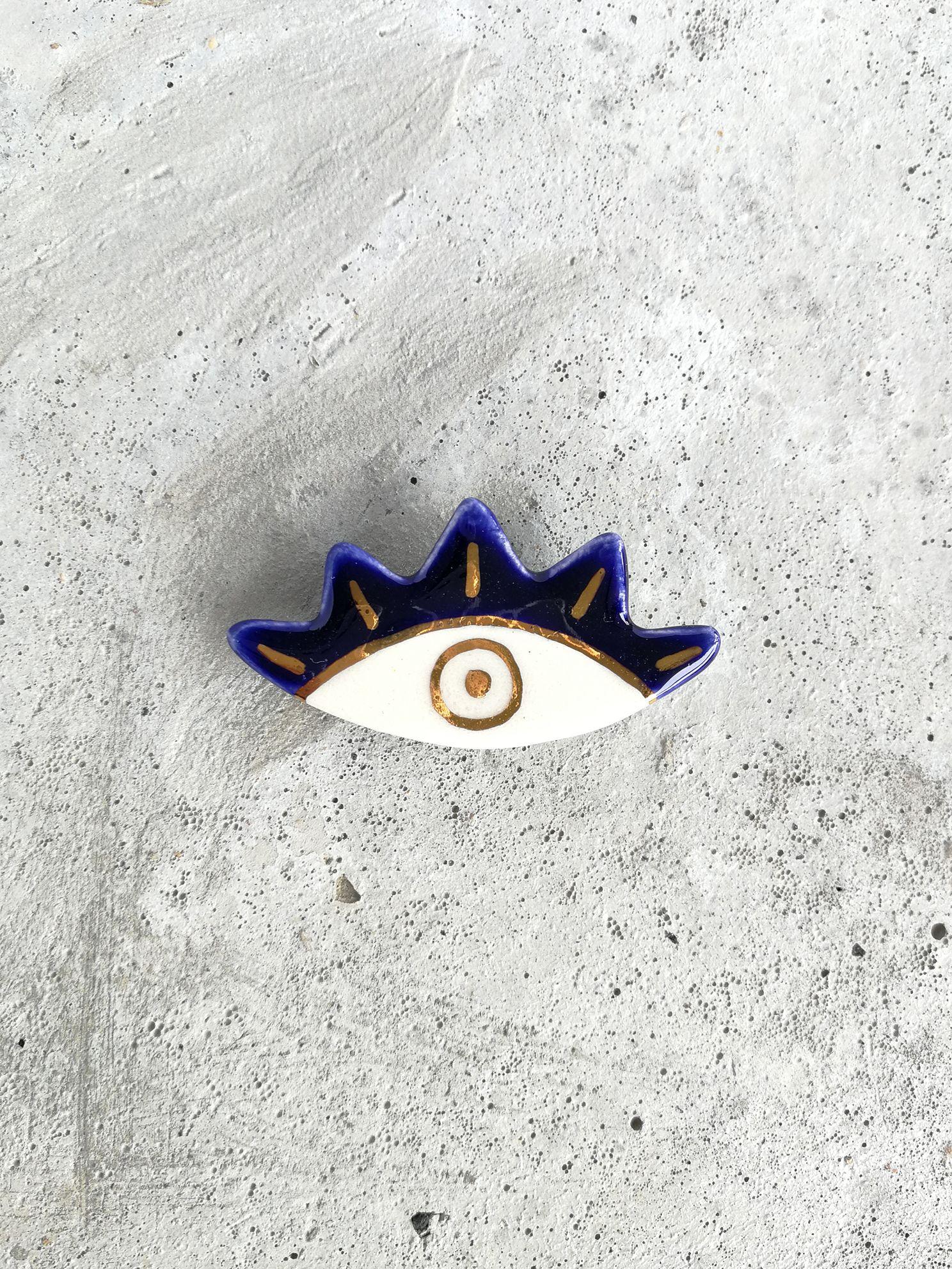 Prendedor de Cerámica Ojo Rayos Oro Azul